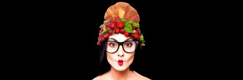 Fun woman with strawberry hat on the white background